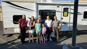 Hexum family in front of their new RV camper