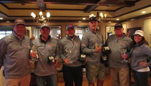 Hosts Mike and Angie Skinner pose with the winning golf team. Left to right: Mike Skinner, Jack Sprague, Brian Donarski, Ken Huff, Wayne Auton and Angie Skinner.