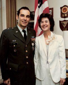 Eugene departs Defense Test & Eval office with medal in 1983
