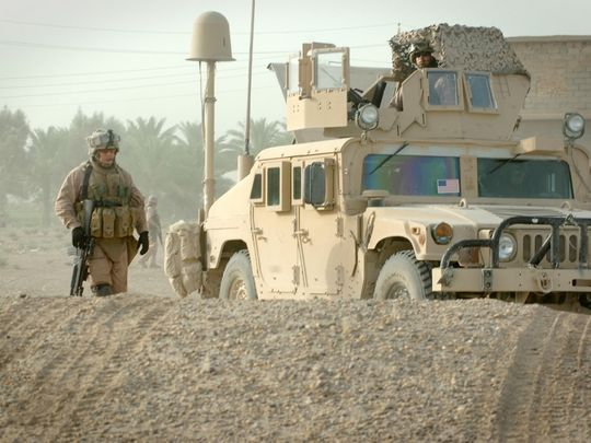 Sgt. Ryan Harshman from Headquarters Battery, Second Battalion, 10th Marines Jump Command Post (2/10 Jump CP), patrols the village of Al Fayil, Iraq, on July 16, 2007. (Photo: Chief Warrant Officer Brook Kelsey, Defense Video Imagery Distribution System)