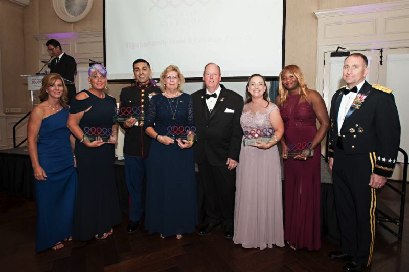 "The 2017 Vigiano Family Hope and Courage Award recipients. Left to right: Robin Kelleher, President and CEO of Hope For The Warriors, Hope Linder, Mario Alcala, Cindy Roberts, Bob Roberts, Dana Abudayeh, Gabby Mack and keynote speaker General Robert B. ""Abe"" Abrams"