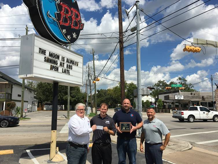 Scott Mitchell, event organizer for the 6th Annual Kingwood Fallen Heroes Memorial Golf Tournament, presents $30,000 to James Elmore and Gus Cabarcas from Hope For The Warriors alongside of Ross Vullard from BB's.