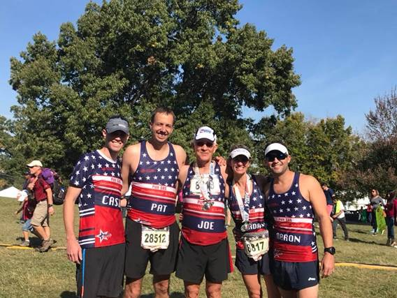 Five Team Hope For The Warriors members celebrate completing the 42nd Annual Marine Corps Marathon.