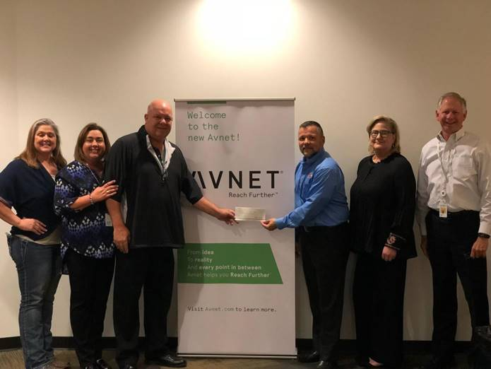 Avnet employees present Hope For The Warriors' Gus Cabarcas with a donation of $15,000 from their recent Driving For Heroes golf event.