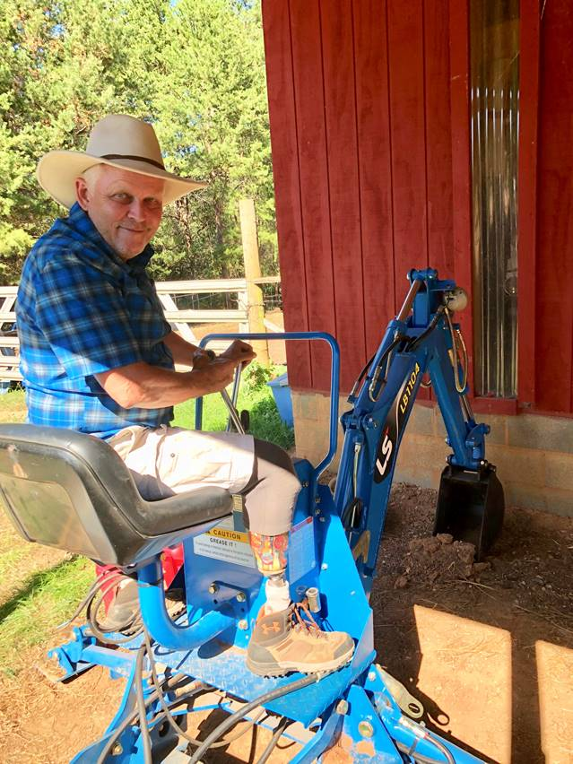 Tennessee-based Army Captain Michael Trost received A Warrior's Wish of a backhoe from Hope For The Warriors to aid in his expanding hops farm business.