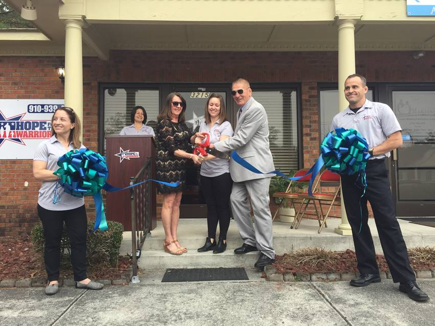 Photo caption: (left to right) Jenna McDonald (Hope For The Warriors), Raquel Painter (Hope For The Warriors), Laurette Leagon (Jacksonville Chamber of Commerce), Brittany Hunter (Hope For The Warriors), John Kopka (Hope For The Warriors) and Ed Raimo (Hope For The Warriors) at the opening of the second North Carolina Hope For The Warriors office. For more photos, visit: http://bit.ly/2GEZgtW.