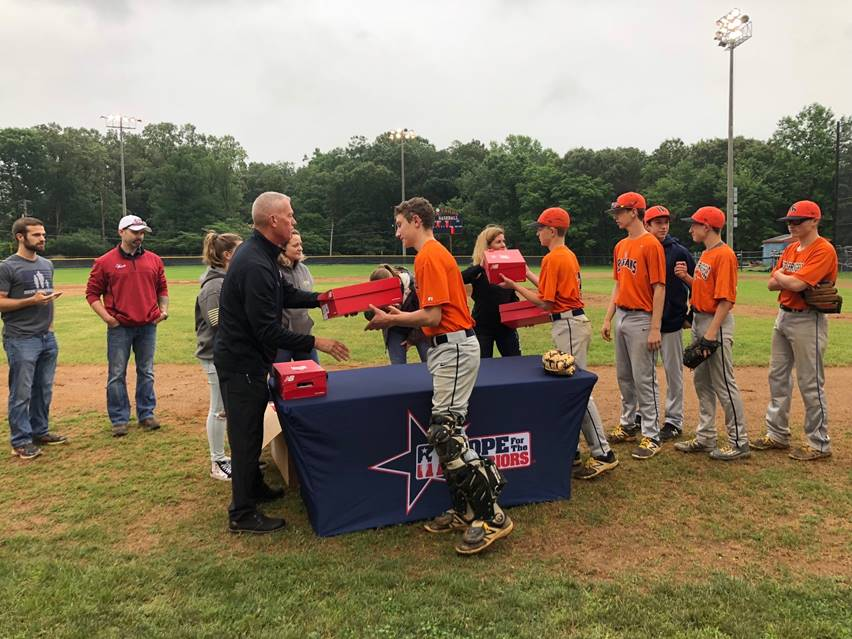 The West Springfield JV baseball team being presented with military-inspired cleats from Hope For The Warriors and its community donors. For more photos visit, https://bit.ly/2y7fQTR.