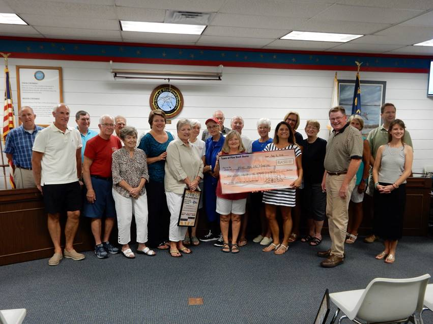 The Town of Pine Knoll Shores presents the 11th Annual Kayak for the Warriors proceeds to Hope For The Warriors staff members.